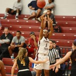 Kareese Johnson of Florida Tech shoots over Lauren Ellenberger (4) of Embry-Riddle during their game Saturday at the Clemente Center.