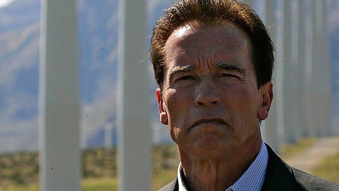 Arnold Schwarzenegger speaks about green jobs on a windfarm in Palm Springs in March 2010.