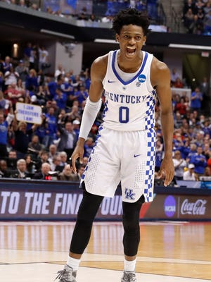 Kentucky Wildcats guard De'Aaron Fox (0)  reacts after a dunk against the Wichita State Shockers during the second half in the second round of the 2017 NCAA Tournament at Bankers Life Fieldhouse.
