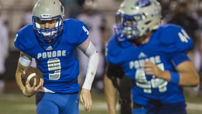 Poudre High School quarterback James Campbell runs during a game against Fossil Ridge at French Field Friday, October 2. The Impalas face Pomona in the Class 5A playoffs on Thursday.