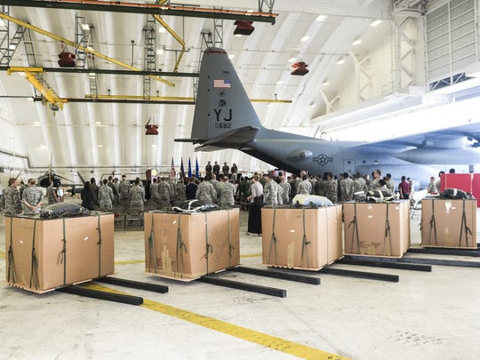 Boxes of supplies can be seen during a push ceremony
