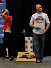 Kristi Cunningham of Roanoke reacts to the tension in her cornhole match against Jerry Shaw of Fort Worth Saturday.