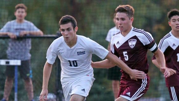 Jack Beer of Byram Hills keeps the ball away from