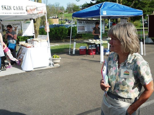 Donna Bednar found happiness on market day just standing, looking and listening to the sounds of the Loveland Farmers' Market.
