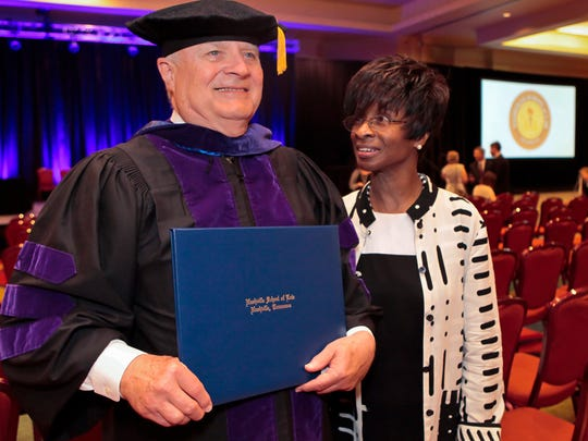 Nashville School of Law graduate Jim Edwards of Murfreesboro stands with his wife, Dr. Gena Carter.