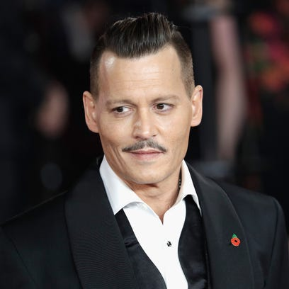 Johnny Depp sported a finely coiffed pompadour at the