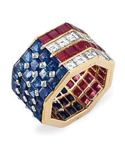 This undated photo provided by Christie's shows a Bulgari diamond, sapphire and ruby ring set in an American flag motif that was once worn by Nancy Reagan.