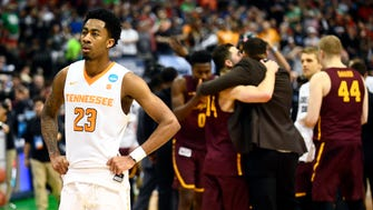 Tennessee guard Jordan Bowden (23) reacts as Loyola-Chicago players celebrate their 63-62 win against Tennessee during the NCAA Tournament second round game at American Airlines Center in Dallas, Texas, on Saturday, March 17, 2018.