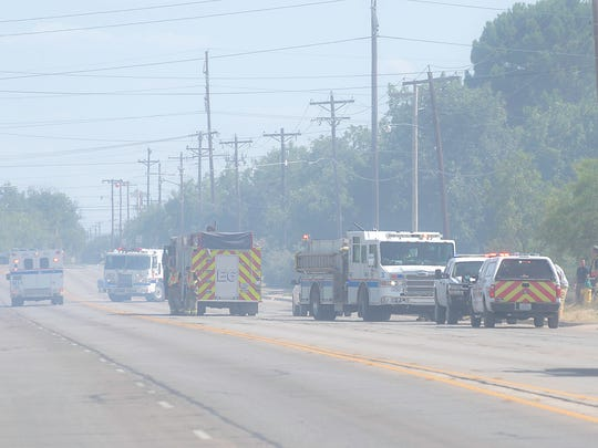 Armstrong Street was closed for several hours as firefighters from multiple fire departments fought to suppress multiple brush fires in the area July 29, 2017.