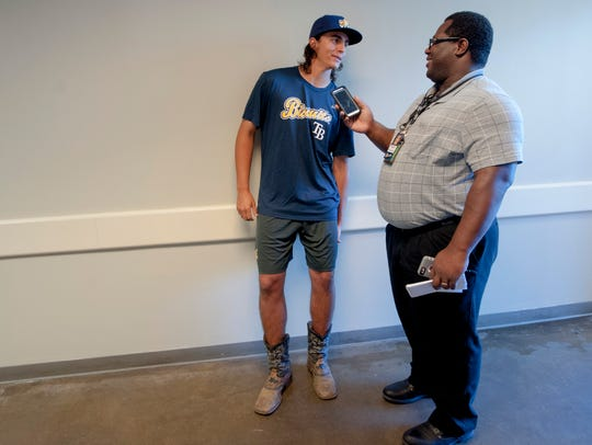 Pitcher Brent Honeywell, left, wears his cowboy boots