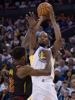 Kevin Durant shoots the basketball against Jeff Green during the third quarter at Oracle Arena.