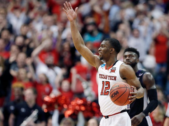 Texas Tech guard Keenan Evans (12) celebrates a win over Stephen F. Austin during a first-round game at the NCAA college basketball tournament in Dallas, Thursday, March 15, 2018. (AP Photo/Brandon Wade)