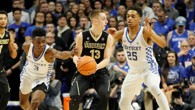 Vanderbilt Commodores guard Riley LaChance (13) dribbles the ball against Kentucky Wildcats guard Hamidou Diallo (3) and forward PJ Washington (25) in the first half at Rupp Arena.