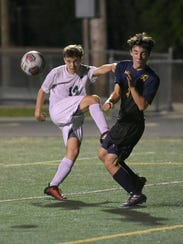 Groves' junior midfielder Nick Restrepo (14) Groves