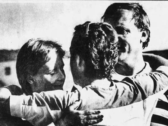 Jean and David Lindsey get a hug from Binghamton Councilwoman Judith Eggleston in June 1984, when Stow Park was renamed for Cheri Lindsey.