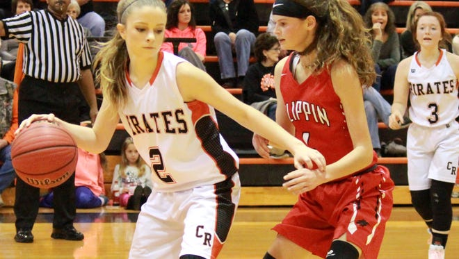 Calico Rock's Kenlee Killian is guarded by Flippin's Makenna Johnson on Tuesday night at Calico Rock.