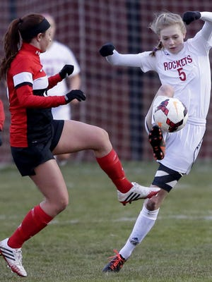 Neenah's Alyssa Barnes (right), battling with Kimberly's Jessica Winkler for the ball during an April 12 game, has been chosen as a WIAA Scholar Athlete.