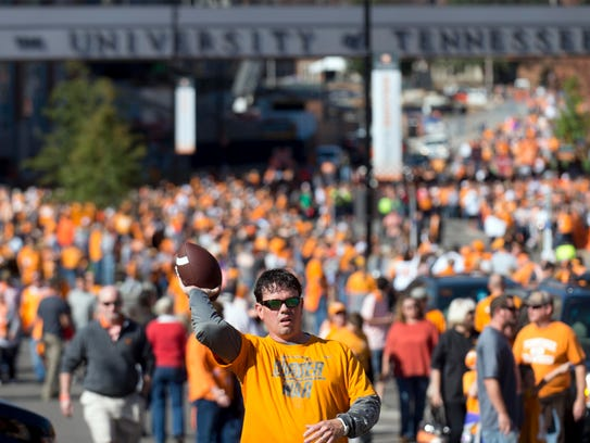 Football fans fill the streets outside Neyland Stadium