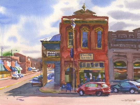 "Watercolorist Wyatt Waters painted Square Books while in Oxford with restaurateur Robert St. John. The painting is included in their new book, ""A Mississippi Palate."""
