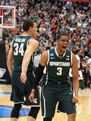 Michigan State's Alvin Ellis III and Gavin Schilling celebrate the 76-70 win over Louisville today in Syracuse, N.Y.