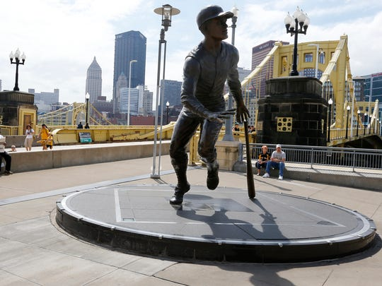 A statue of Roberto Clemente sits outside of PNC Park in Pittsburgh.