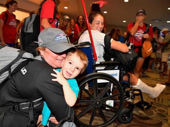 Coach Nicole Aquile is greeted by her son Cooper Stephens