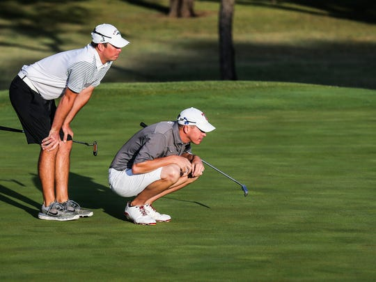 Kevin Crane, left, and Murray Carson finished second by one shot at the Bentwood Country Club men's partnership on Saturday.