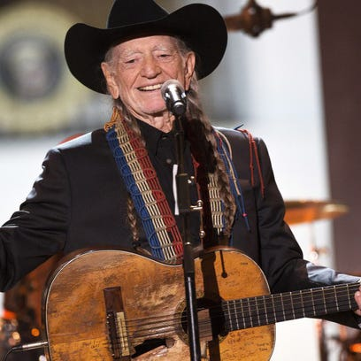 Country star Willie Nelson and his reliably battered