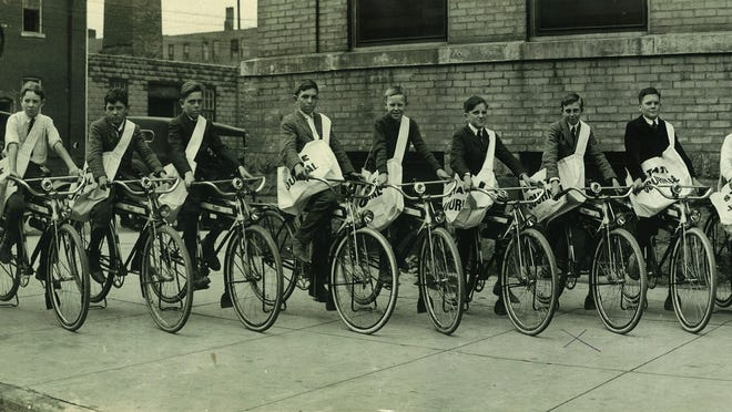 LSJ paperboys from the 1920s posing with their bicycles and paper delivery bags. Robert Torgerson is second from the right.