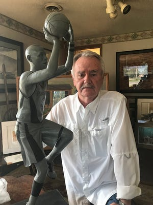 Bill Wolfe sculpts historical figures and athletes, including Indiana Pacers legend Reggie Miller.