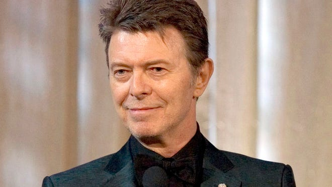 In this June 5, 2007 file photo, the late singer David Bowie accepts the lifetime achievement award at the 11th Annual Webby Awards in New York.