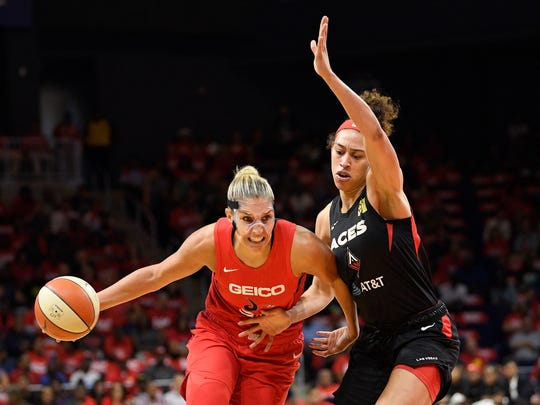 Washington Mystics forward Elena Delle Donne, left, drives to the basket against Las Vegas Aces forward Dearica Hamby during the first half of Game 1 of a WNBA playoff basketball series Tuesday, Sept. 17, 2019, in Washington. (AP Photo/Nick Wass)