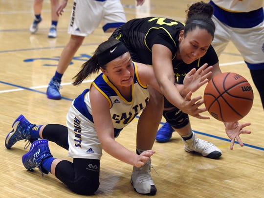 McKenna Tutt of Castle tries to gain possession of a loose ball along with Lexi Joyner of North during the second quarter of the SIAC girlsÕ basketball tournament at Castle High School Friday.  North won the game 51-39 to advance.