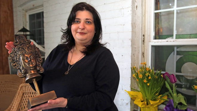 Jennifer Toscano Huber of Stony Point has collected items from her home that she plans to sell during a group tag sale.