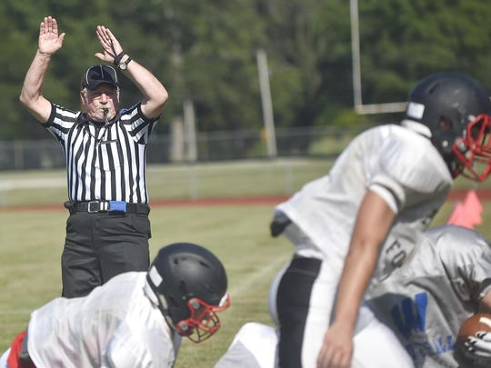 Referee Norm Abraham makes a call during a football scrimmage at Pleasant High School. Abraham has been officiating football games for 51 years.