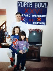 Bills fan Pierre HeŽroux with daughters Nicole Williams and Michelle Conlon during Super Bowl XXVI, a year after this story started.