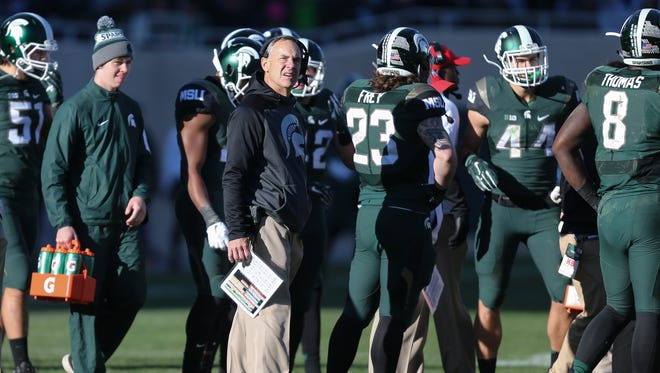 Michigan State coach Mark Dantonio during a time-out called by Maryland Terrapins during the second half Saturday in East Lansing.