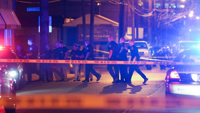 LMPD officers investigate the scene of a multiple shooting near Clay and Jacob streets in Smoketown.Aug. 24, 2016