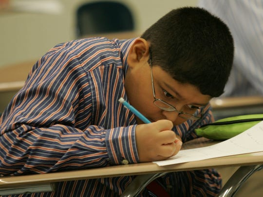 A student works on a test during class. Christian Brothers