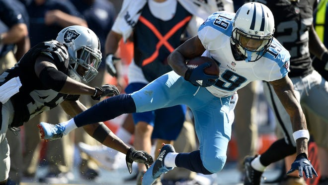 Titans wide receiver Tajae Sharpe (19) tries to gain some yards after a catch during the Titans' last possession against the Raiders at Nissan Stadium Sunday, Sept. 25, 2016, in Nashville, Tenn.