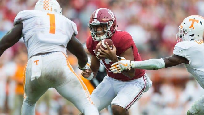 Alabama quarterback Tua Tagovailoa (13) rushes against Tennessee last season.