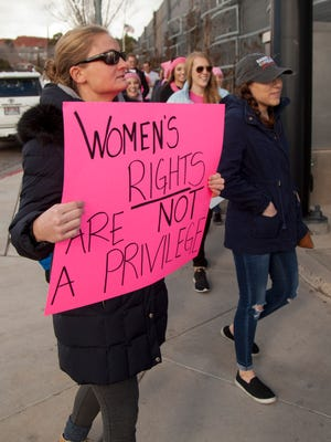 A St. George resident holds a sign advocating for equal rights during a march in solidarity with women around the country on Saturday, Jan. 21, 2017.