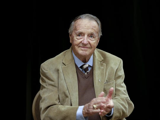 Retired Florida State NCAA college football coach Bobby Bowden applauds following a Rotary Club luncheon in Omaha, Neb., in 2018. Bowden, hospitalized last week after contracting COVID-19, says he is feeling better and hopes to go home soon.