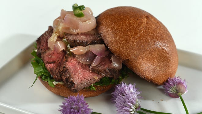 The Francovich family, longtime owners of the Grill at Quail Corners, created tri-tip sliders crowned with a topknot of vinegared shallots for the Toast & Taste of Summer benefit June 4 at the Atlantis. The herbs and purple chive flowers are from the family garden.