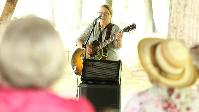 Ellen Treon, a Baha'i from Charlotte, NC sang several songs Sunday for the Unity in the Park held at Conger Park.