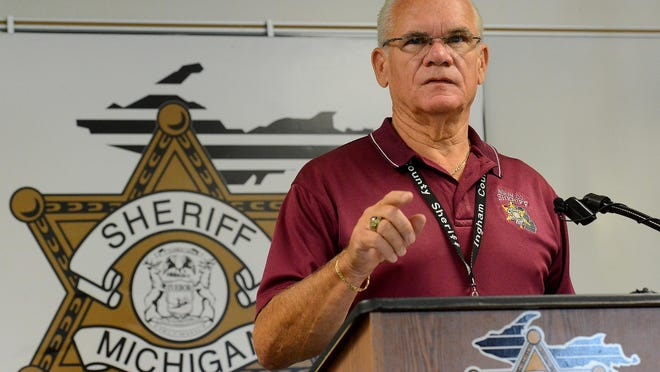 Ingham County Sheriff Gene Wriggelsworth speaks during a press conference Friday.