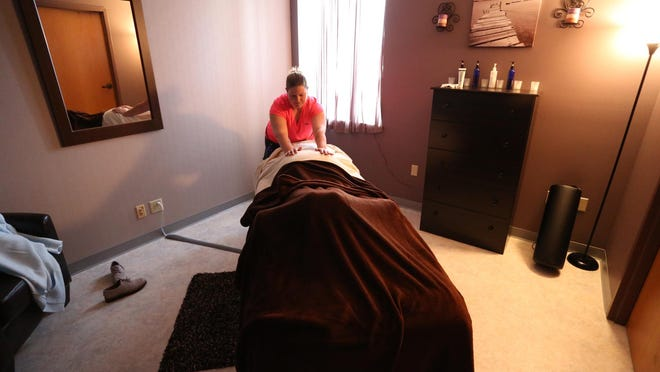 Mandy Zschernitz works on a client at A-Z Massage in Marshfield, Oct. 13, 2015.