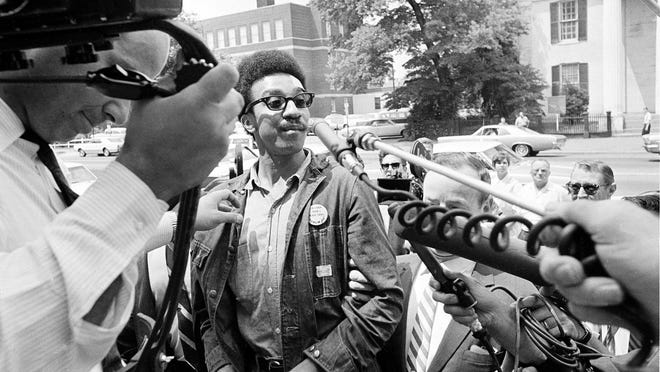 A handcuffed H. Rap Brown is led into a federal building cell block July 26,1967 in Alexandra ,Va, after being arrested by FBI agents. Brown, charged with complicity in a riot at Cambridge,Md, was being held pending a hearing on his removal to Maryland. He is the head of the Student Nonviolent Coordinating Committee. (AP Photo) [Via MerlinFTP Drop]