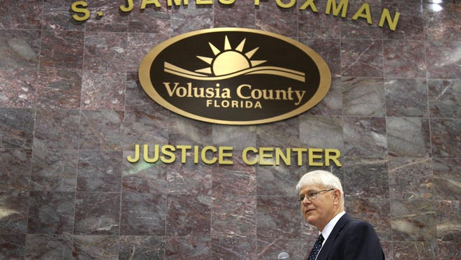 Retired Judge S. James Foxman talks during at the naming ceremony of the S. James Foxman Justice Center in Daytona Beach, Saturday, February 5, 2011.