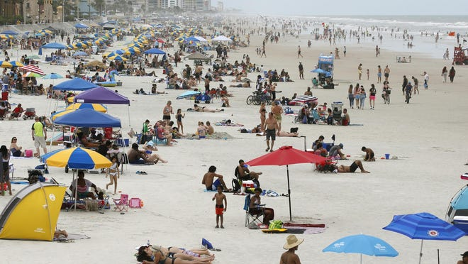 Beachgoers take to the sand over Memorial Day weekend in Daytona Beach. Hoteliers have been anticipating another strong holiday weekend over July 4th, but recent record-setting coronavirus case numbers in Florida might be keeping some visitors at home.